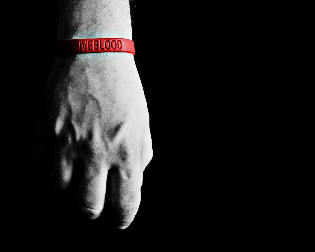 hand with red wrist band